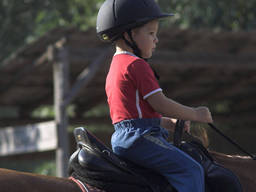 Even younger kids can give horse riding a go!