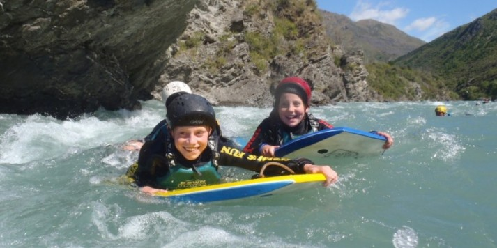 Kids having a blast riversurfing