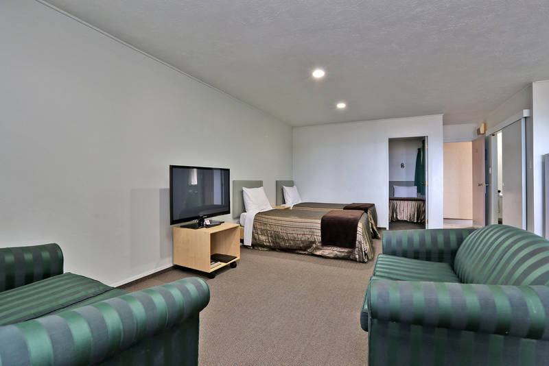 Family unit - Has 3 x 2-seater couches, a table that seats 6 and a full kitchen.